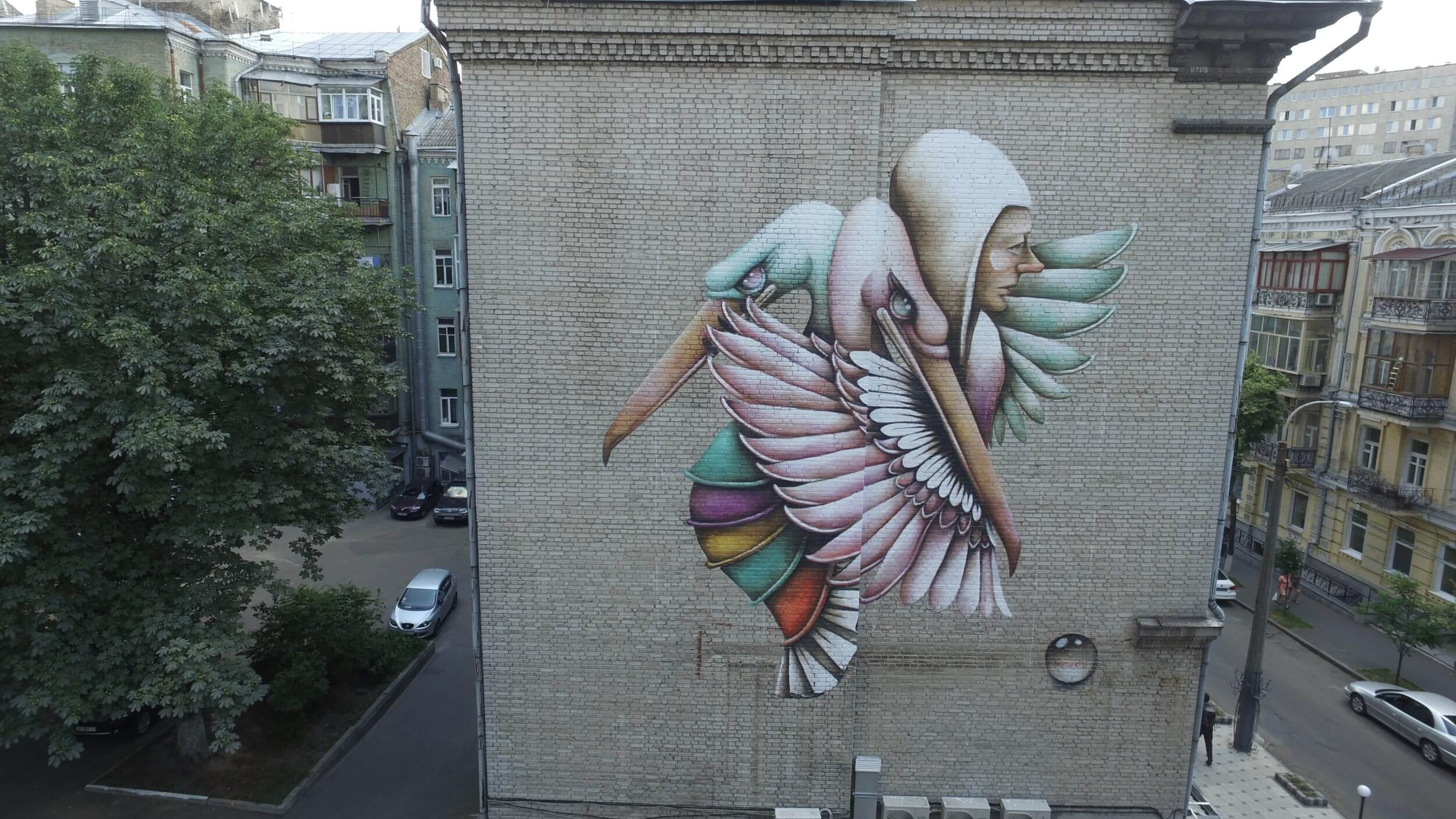 Street artist Ana Marietta Embraces Peace in Kiev, Ukraine 2016