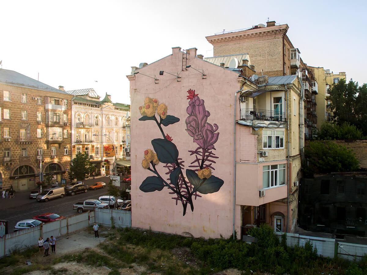 Street Artist Pastel paints thistles in Kiev, Ukraine 2016