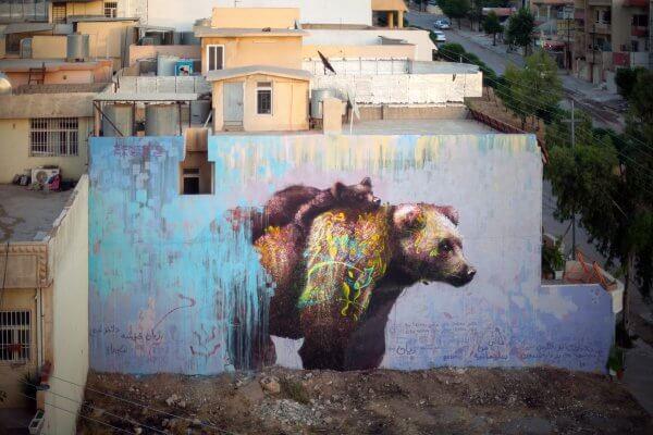 Ernesto Maranje, Bear with cub street art mural, Iraq 2017. Photo credit aptART