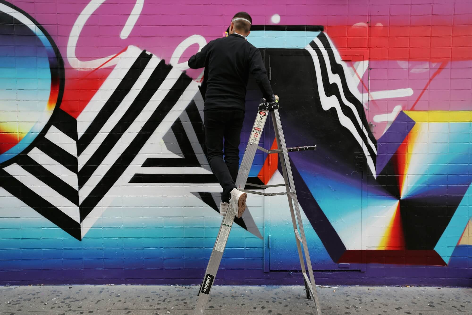 His style is characterised by the use of bold colours geometrical patterns and op art elements