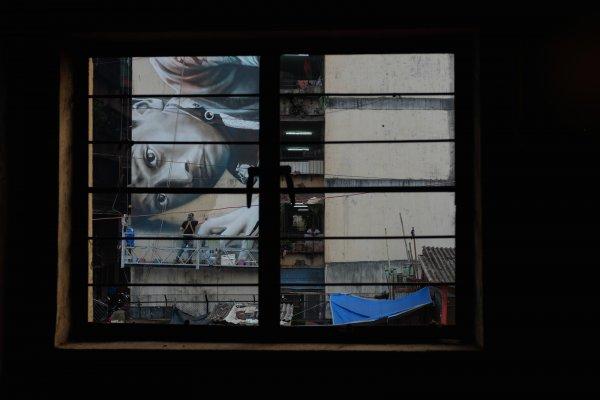 Guido Van Helten, Mahim (E) Art District, St+art Urban Art Festival, Mumbai 2017. Photo Credit Akash Shukla